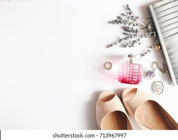 Feminine beautiful white background, cosmetics,flowers, purse, parfume. Accessories, nude shoes. Top view. Fashion background. Beauty products. Space for text. Bridal.