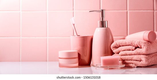 Feminine beauty and spa products.Stack of towels,cosmetic cream and toothbrush.
