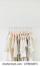 Feminine clothes on hanger. Minimal fashion composition on white background. Lifestyle concept.