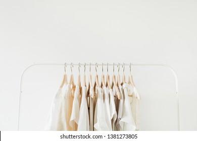 Feminine clothes on hanger. Minimal fashion composition on white background.