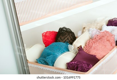 Feminine lacy underwear in a wardrobe
