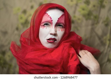 Feminine mistrust, lie concept. A woman with a painted face and incredulous facial expression.
