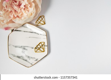 Feminine Pink Styled Desktop with marble plate, blush pink peony, and gold diamond paperclips