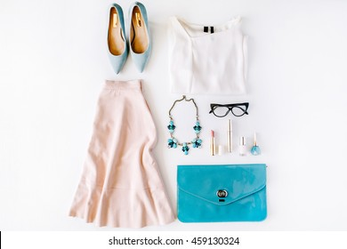 feminine summer clothes and accessories collage on white background. flat lay, top view