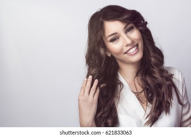 Feminine tended young woman, studio shot