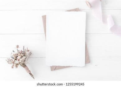 Feminine wedding, birthday desktop mock-up. Invitation card mockup, template Blank greeting cards, rspv card, 5x7, card, craft envelope. Silk ribbons, pink, dry flowers. White wooden background. Flat