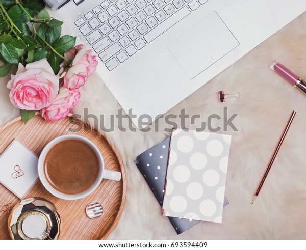 Feminine workplace concept, top view. Work from home.