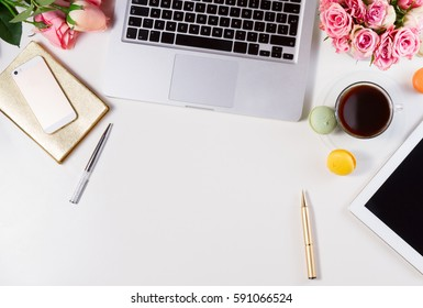 Feminine workspace - workspace with keyboard, coffee and flowers, top view