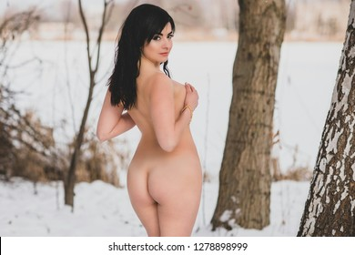 Femininity and sensual concept . Young sexy woman with full hips posing outside in the winter