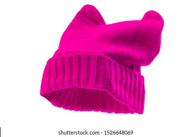 Feminism, social rebellion and struggle feminist values conceptual idea with pink knitted pussy hat with cat ears isolated on white background and clipping path cutout using ghost mannequin technique