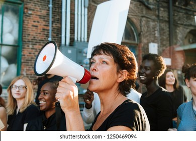 Feminist with a megaphone at a protest