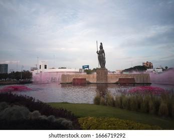 Feminist protest Fuente de la Minerva / Minerva Fountain.  Guadalajara, Jalisco, Mexico - February 7th 2020.  Feminist protestant dyed in red the water of the Minerva Fountain