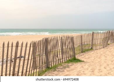 Fence along an empty beach