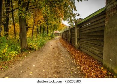 Fence around the monastery in autumn