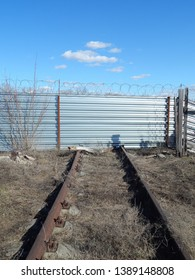 The fence with barbed wire to protect the territory. Closed perimeter of the protected enterprise.
