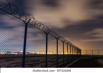 Fence with barbed wire, restricted area