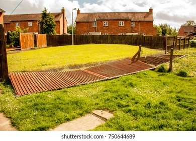 A fence blown down by strong winds at a person's property.