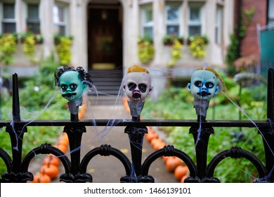 fence with creepy doll heads. Halloween decorations