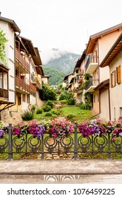 fence decorated with flower vases in the Levico Terme , a village in the Italian Alps
