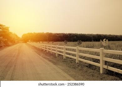 Fence in farm field. Vintage filter