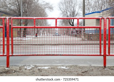 Fence in the form of a red grid protecting the highway overlooking the park