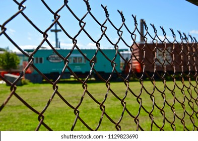 Fence in front of discarded old trains