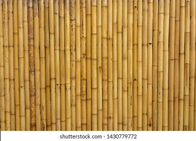 The fence of the house is made of bamboo