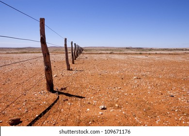 Fence line in southern Queensland in the Australian Outback.