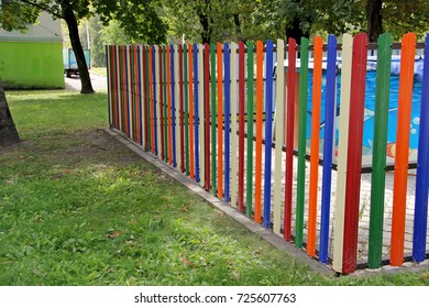 A fence made of multicolored metallic straps