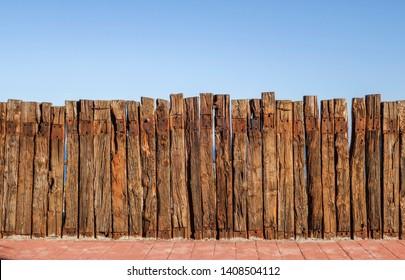 Fence made of Railway Sleepers, logs.