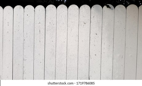 The fence is made of white painted wood. As a background texture.