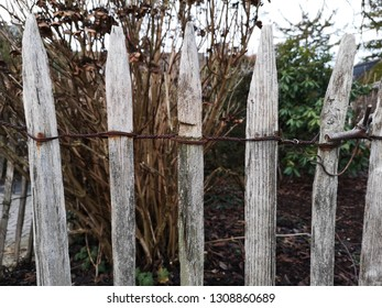 fence made of worn wood and rusty wire