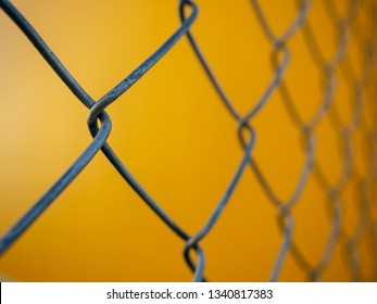 Fence mesh yellow background