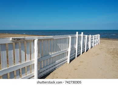 Fence on beach, Apulia, Italy.