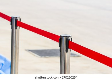 The fence pole with attached red ropes