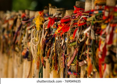 The fence posts of the killing fields, in Cambodia, are covered with bracelets. It is a way of remembrance and tribute to the victims of the regime.