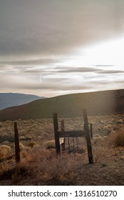 fence posts and fence in rural valley mountains background California, USA