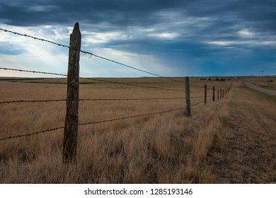 Fence in the Savanah near the Minuteman Nuclear Missile Site, South Dakota, USA