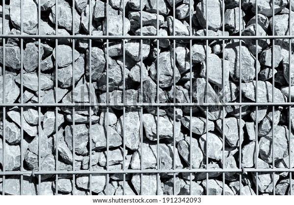 a fence with stones and metal