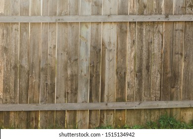 fence of unpainted wooden boards