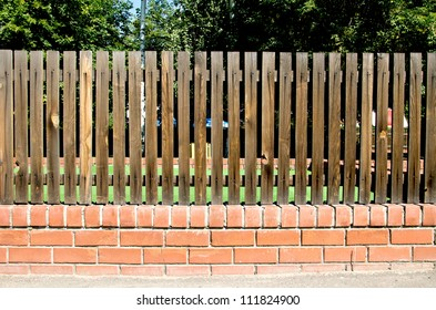 garden fencing panels. Fence Of Wooden Slats On The Bricks Garden Fencing Panels