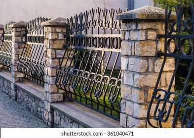 fence, wrought iron fence, forging and stone, wrought-iron ornaments,horizontal photo