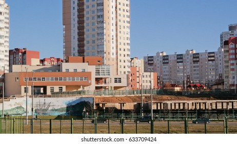 A fenced construction site in the city, with the laid Foundation for construction of houses.
