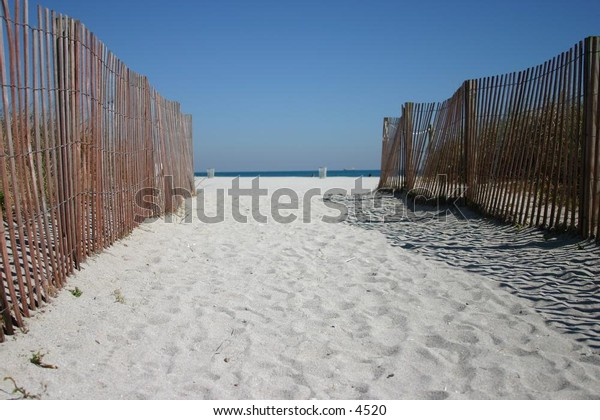 fenced pathway to the beach