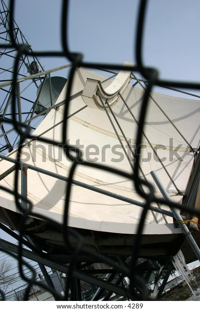 fenced in satellite dish
