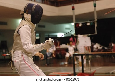 Fencer duelist is on guard preparing to fight in fencing sport