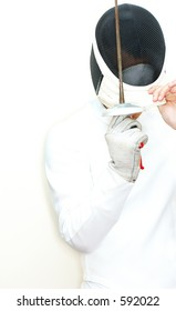 fencer removing/putting on mask  in high key