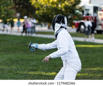 Fencing athlete in attacking position