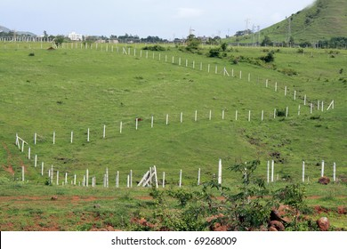 Fencing laid to mark empty plots on a landscape.