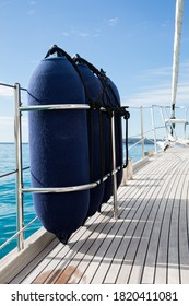 Fenders stored on deck of a yacht
